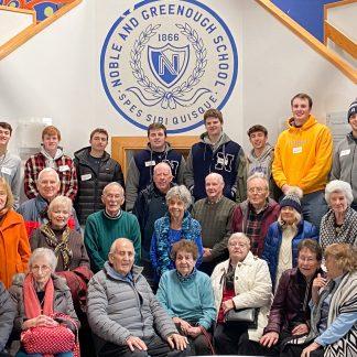 Nobles student volunteers with elder friends, the Golden Dawgs
