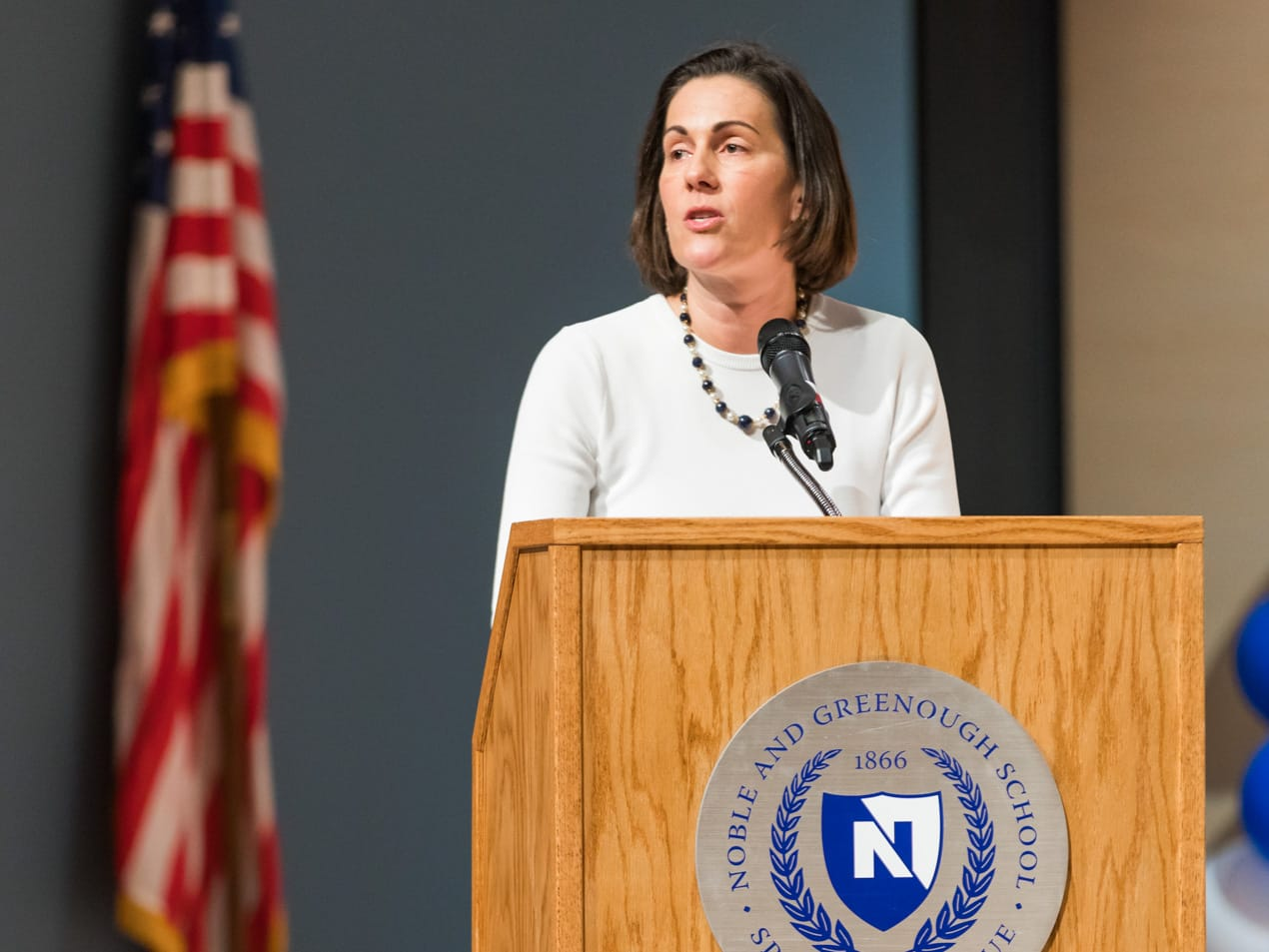 Cathy Hall speaking at a graduation