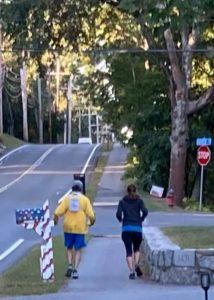 Mark Sheeran and Meg Jacobs running at mile 20